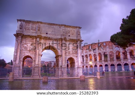 Constantine Arch and coliseum at dusk, a rainy day. HDR. - stock photo
