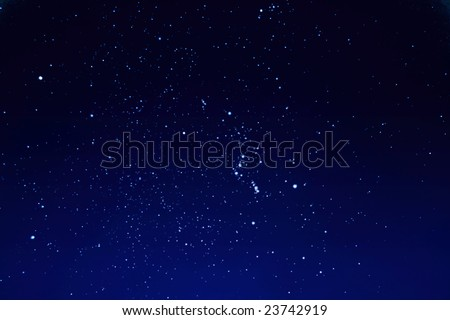 Constellation of Orion in night sky - stock photo