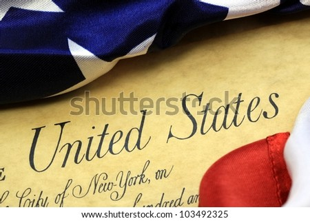 Constitution of the United States and American Flag - stock photo