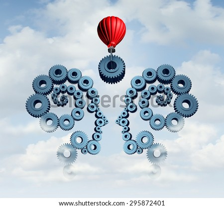 Constructing a business partnership concept with gears connected together shaped as a human head team with a red balloon placing a key cog in the center to connect the partners. - stock photo