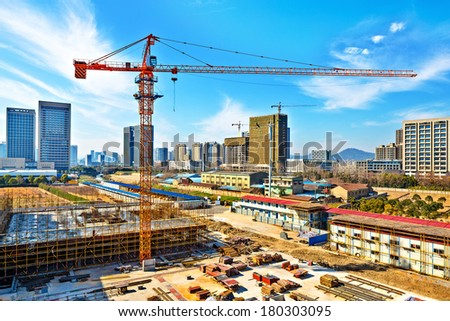Construction activity of a tall skyscraper intended for use as an office building - stock photo