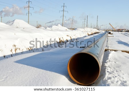 construction and installation of underground gas pipeline of high pressure in winter conditions - stock photo