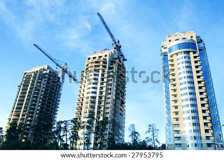 construction and real estae concept. multistoried buildings - stock photo