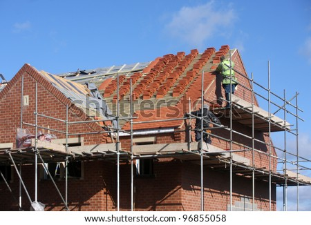 Construction and Roof in progress to new house in UJ - stock photo