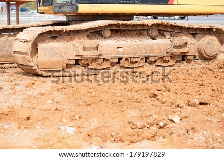 construction area with dirt and heavy equipment