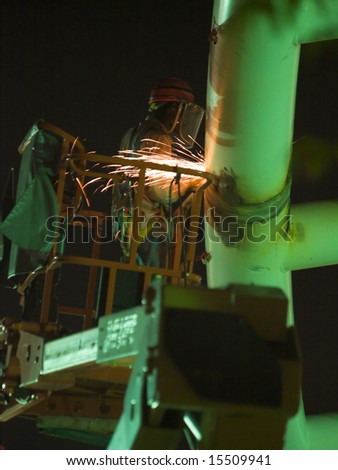 Construction at Night to Meet Project Deadline - stock photo