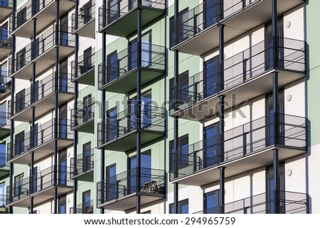 Construction background picture of modern apartment building with balconies  - stock photo