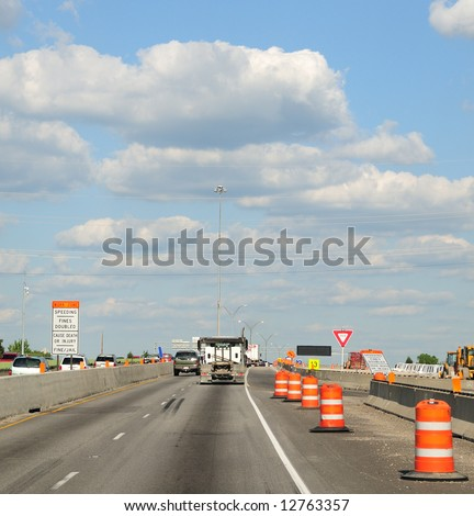 Construction Barrels Along The Interstate Highway - Traffic Along The Interstate Highway In Construction Zone,  Ohio USA - stock photo