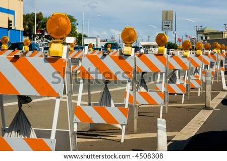 Construction barricades in a row along a road - stock photo