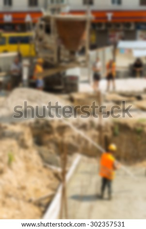 Construction blurred background with bokeh - stock photo
