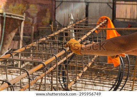 Construction builder at work. Tying reinforcement preparation for concreting. - stock photo