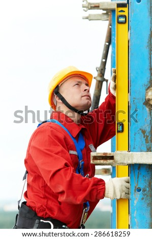 construction builder worker joiner inspecting formwork for concrete pouring at building site  - stock photo