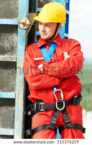 construction builder worker joiner working with formwork for concrete pouring at building site  - stock photo