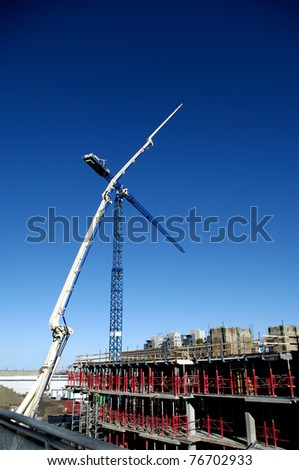 construction building and industrial crane and manlift machinery . primary colors are red white and blue and wood brown. - stock photo