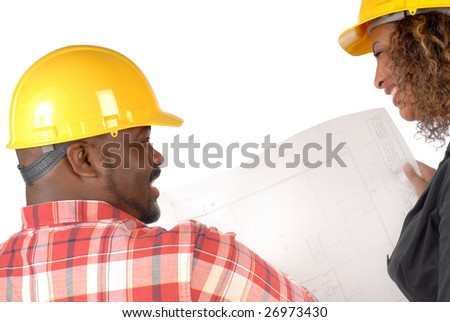 Construction business team looking over a blueprint - stock photo