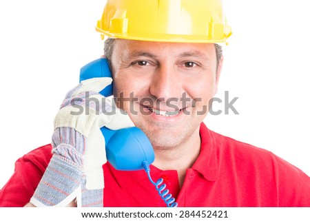 Construction company contact, assistance or support concept with builder using phone - stock photo