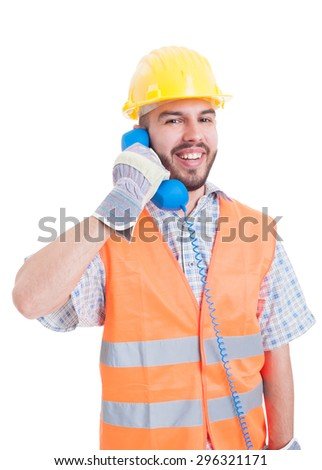 Construction company contact person holding phone with friendly smile - stock photo