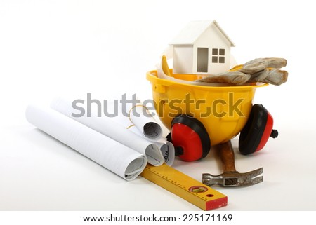 construction concept-  house model,  industrial tools and protective gear  - stock photo