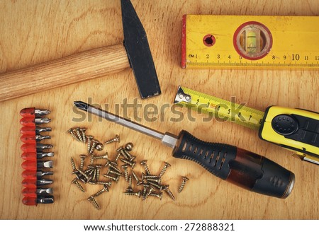 construction concept  Set of manual tools on a wooden boards background - stock photo