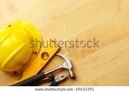 construction concept with hard hat working tools and copyspace - stock photo