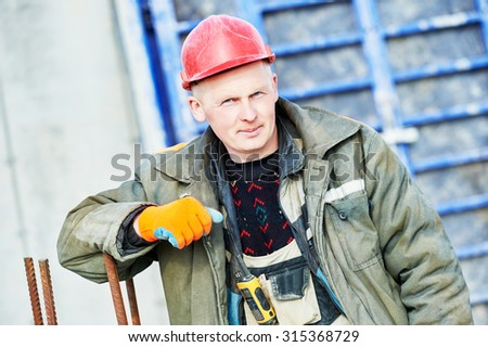 construction concreter builder labour worker at building site  - stock photo
