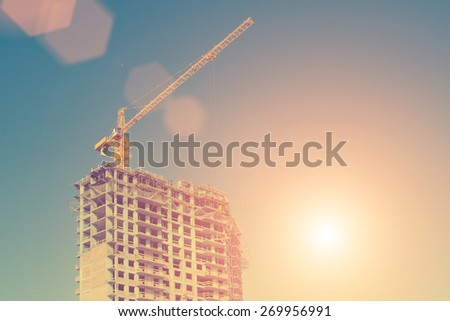 Construction crane and a building house  - instagram style - stock photo