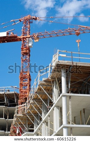 construction  crane and highrise with blue sky