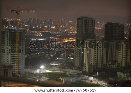 Construction Crane at night with city scape