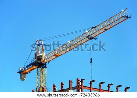 construction crane building a house - stock photo