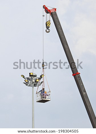 construction crane for lifting two cleaners worker.  - stock photo