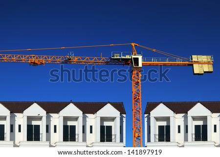 construction crane over the house - stock photo