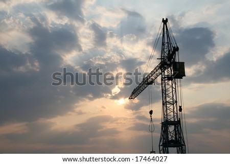 Construction crane silhouette with cool sunset background
