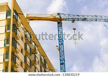 Construction crane with building on the site.