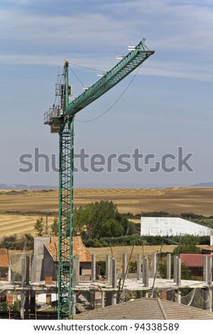 construction cranes in the sky background
