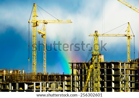 Construction cranes industrial city rain rainbow 01 - stock photo