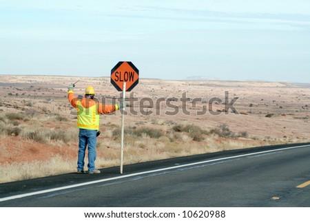 Construction crew man controlling traffic - stock photo