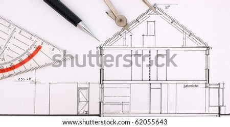 Construction drawing with tools of a family house - stock photo