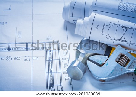 Construction drawings adjustable spanner and claw hammer building concept