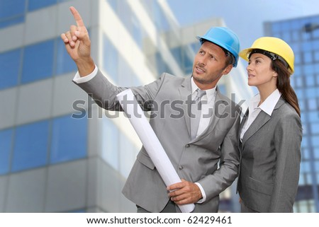 Construction engineer in front of modern building - stock photo