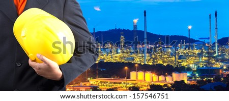 construction engineer with oil plant - stock photo
