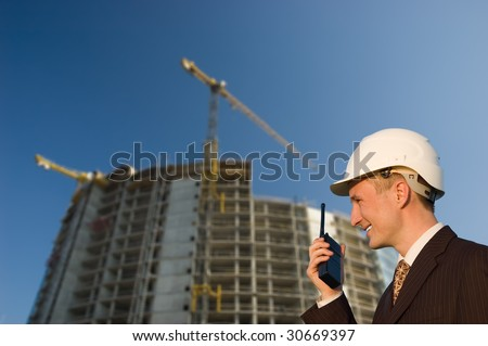 Construction engineering worker/manager talking on radio - stock photo