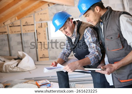 Construction engineers meeting on site - stock photo