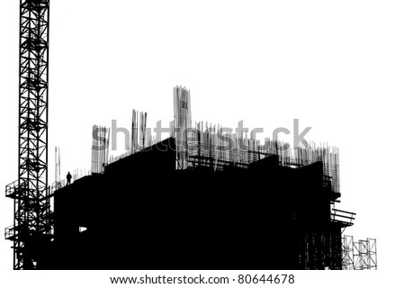 construction equipment and elements of a building under construction - stock photo