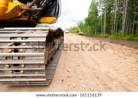 Construction equipment during road works - stock photo