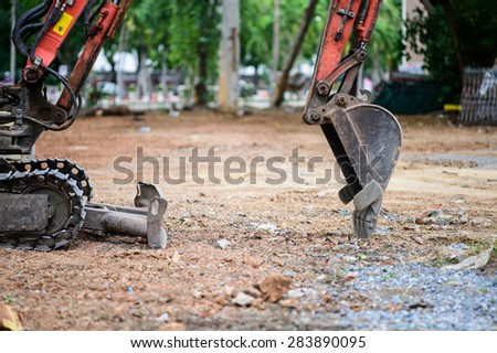 Construction Equipment loader machine during earthmoving works outdoors - stock photo