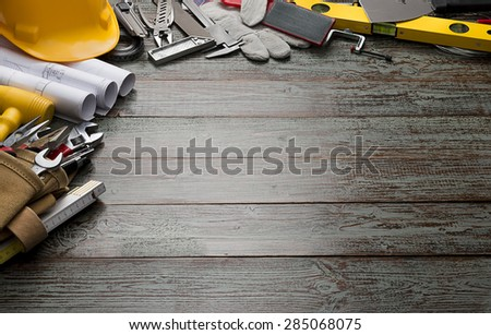 Construction equipments on natural wood background with copy space.   - stock photo