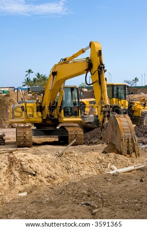 Construction Excavator at a construction job site - stock photo