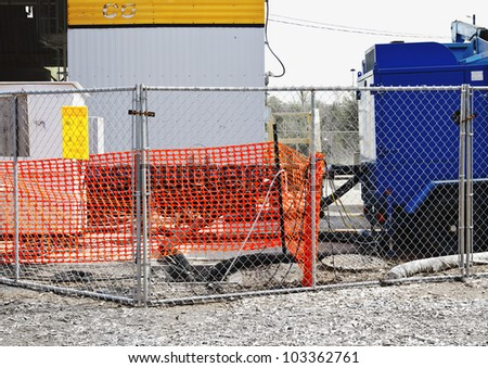 Construction fences and storage units in bright primary colors and rectangular shapes create abstract design. - stock photo