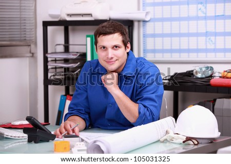 Construction foreman working in the office - stock photo