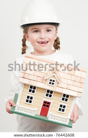 Construction - girl with house model (self made house) - stock photo